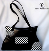 Rita Azzellini offers you an exclusive collection of fine leather fashion handbags, vip chess collection very elegant, prestigious and high qualitative handbags, perfectly well-finished and exclusively hand-made by our experienced italian craftsmen to satisfy all our customers, also the most exacting and sophisticated people. we use for each handbag a very soft kidskin leather, treated and made in Italy. This type of leather guarantee an elegant finished ladies handbag crafted. Our collection designed and created from exquisite kid skin leather features a stunning design to VIP women, for elegant women and to support Boutiques and luxury handbags distributors round the world
